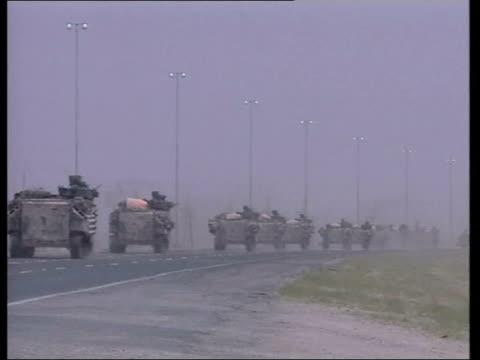 tanks towards tracks of armoured vehicle as along gvs column of armoured vehicles along as advancing on iraqi border british armoured engineers... - 2003 stock videos and b-roll footage