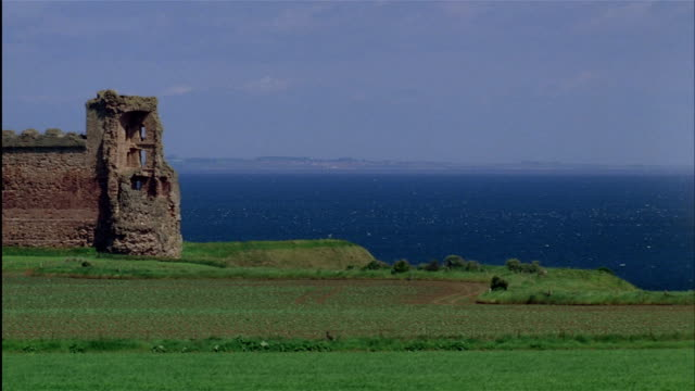 Tantallon Castle overlooks Bass Rock with lighthouse and castle ruins in the Firth of Forth.  East Lothian, Scotland