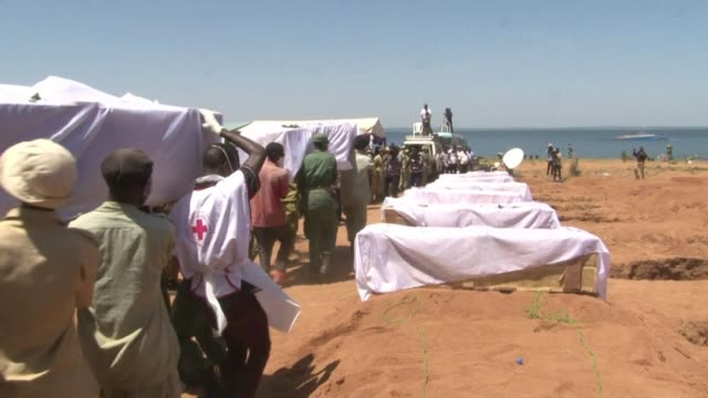 tanzania declares the whole nation in mourning as the first dozen bodies are buried from a devastating ferry capsize on lake victoria that has left... - dozen stock videos & royalty-free footage