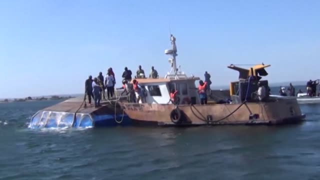 stockvideo's en b-roll-footage met tanzania has declared the whole nation was in mourning as the first dozen bodies were buried from a devastating ferry capsize on lake victoria that... - clean