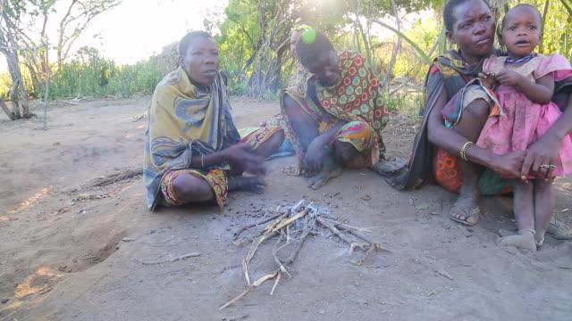 tanzania, lake eyasi, hadzabe tribe, women eating roasted mice - rodent stock videos and b-roll footage