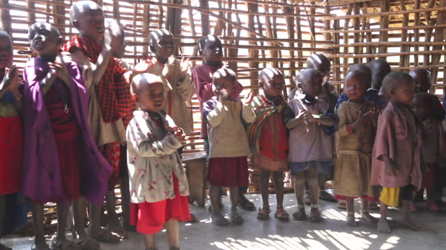 Tanzania, Ngorongoro conservation area (NCA), Masai children singing in a wooden classroom