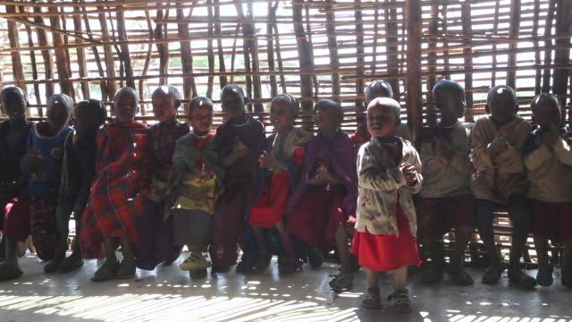 tanzania, ngorongoro conservation area (nca), masai children singing in a wooden classroom - tanzania stock videos & royalty-free footage