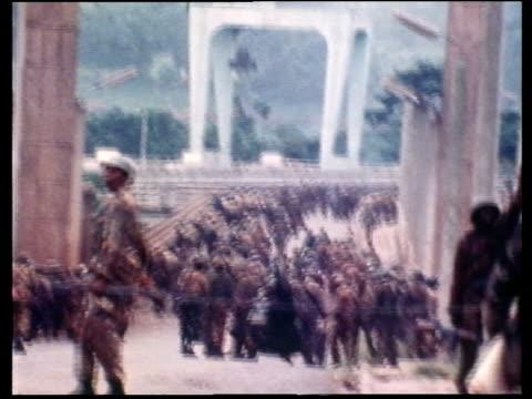tanzanian troop withdraw itn lib tanzanian troops jinjamsgun fired mspan troops lying on ground mstroops towards - army stock videos & royalty-free footage