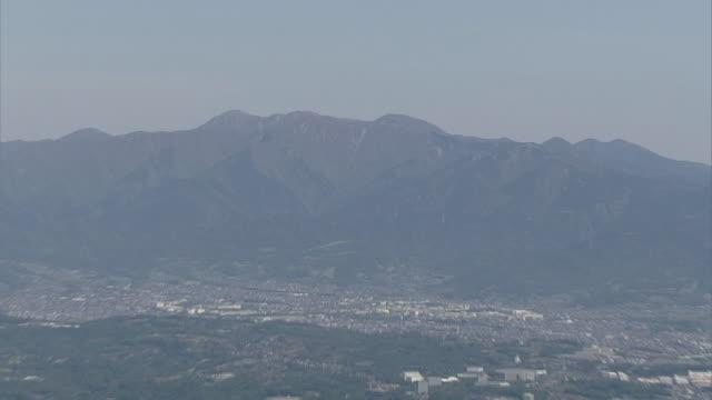 aerial, tanzawa mountains and towns in kanagawa, japan - 相模湾点の映像素材/bロール