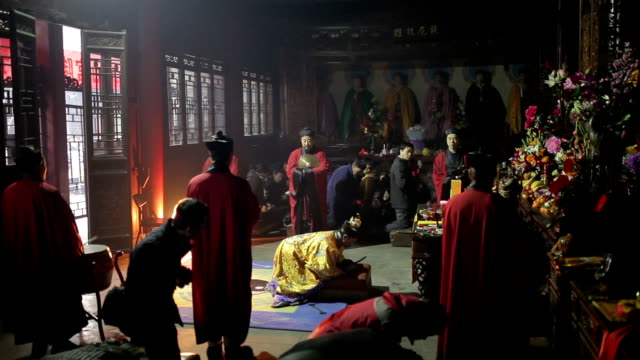 ms taoist do religious rites with pilgrims to pray for good luck in grand hall of temple during chinese lunar new year audio / xi'an, shaanxi, china - ceremony stock videos & royalty-free footage