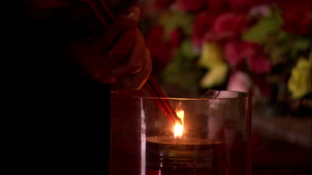 stockvideo's en b-roll-footage met a taoist priest lights a candle and performs a holy ritual. available in hd. - altaar