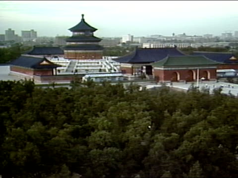 taoist temple complex. hall of prayer for good harvests , triple gabled circular building center of complex. ming, qing dynasty. - temple of heaven stock videos & royalty-free footage