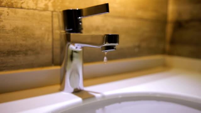 tap water leaks. - plumber stock videos & royalty-free footage
