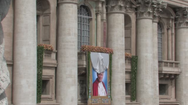 a tapestry featuring the portrait of beatified john paul ii is unveiled the beatification of pope john paul ii at saint peter's square on may 01 2011... - tapestry stock videos & royalty-free footage