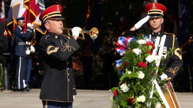 taps is performed during the full honors wreathlaying ceremony at the tomb of the unknowns on veterans day at arlington national cemetery november 11... - アーリントン点の映像素材/bロール