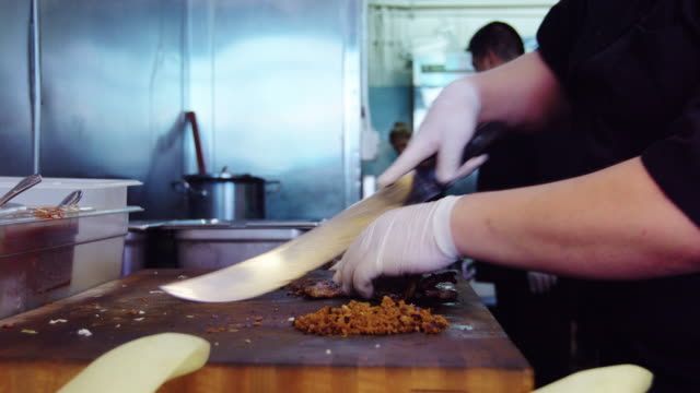 taqueria kitchen workers preparing food - mexican restaurant stock videos & royalty-free footage