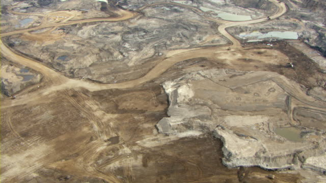tar covers the landscape of the athabasca oil sands near fort mackay, alberta, canada. - alberta stock videos & royalty-free footage