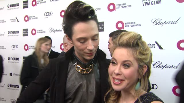 INTERVIEW Tara Lipinski Johnny Weir at Elton John AIDS Foundation Presents 22nd Annual Academy Awards Viewing Party Sponsored By Chopard Neuro Drinks...