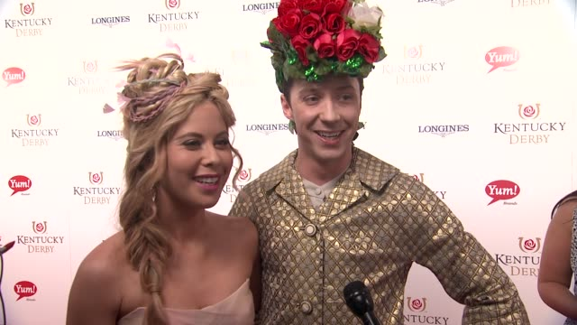 INTERVIEW Tara Lipinski Johnny Weir on being there for the 2nd time and their outfits at 141st Kentucky Derby at Churchill Downs on May 02 2015 in...