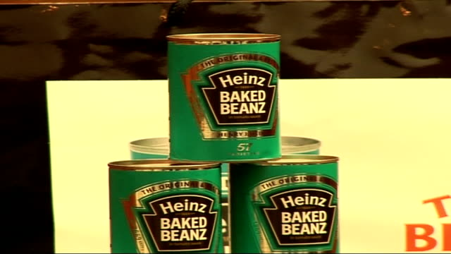 tara palmertomkinson launches heinz beans amnesty photocall / interview tin of heinz baked beans arranged in a pyramid in front of back drop the bean... - bean stock videos and b-roll footage