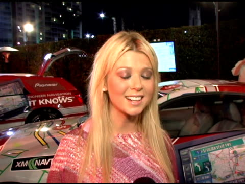 tara reid loves wireimage and uses it for detective work on her friends/boyfriends at the pioneer electronics launch of their automotive navigation... - tara reid stock-videos und b-roll-filmmaterial