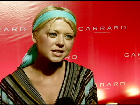 Tara Reid on attending this event jewelry how diamonds enhance fashion jewelry she owns that has special meaning and her outift at the Garrard...