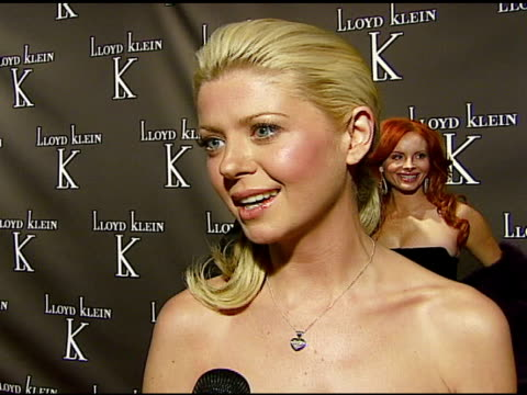 Tara Reid on what she likes about Lloyd Klein's clothes and the dress she is wearing on the new store in LA on why she decided to come forward and...