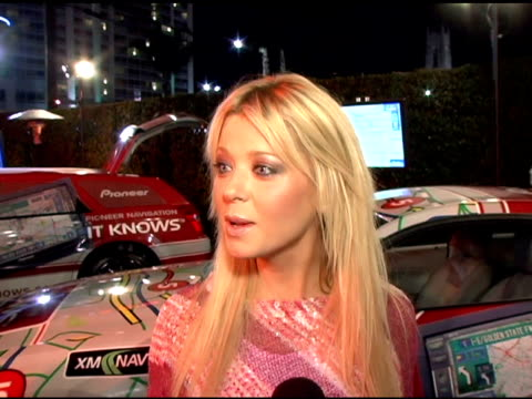 tara reid says that navigation is awesome and her sense of direction is not her forte, she still single and denies any boyfriends and she also says... - tara reid stock-videos und b-roll-filmmaterial