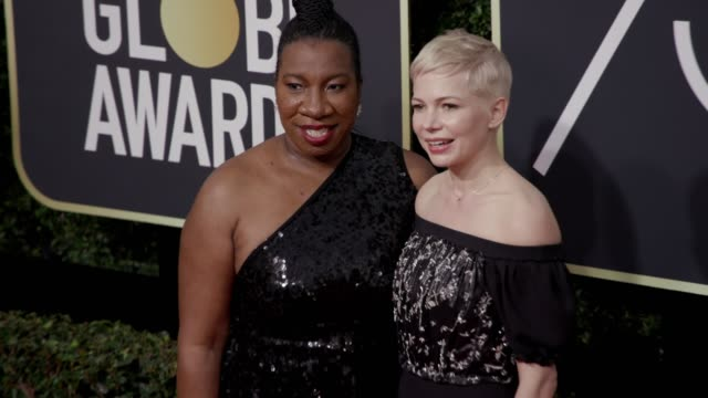Tarana Burke and Michelle Williams at the 75th Annual Golden Globe Awards at The Beverly Hilton Hotel on January 07 2018 in Beverly Hills California