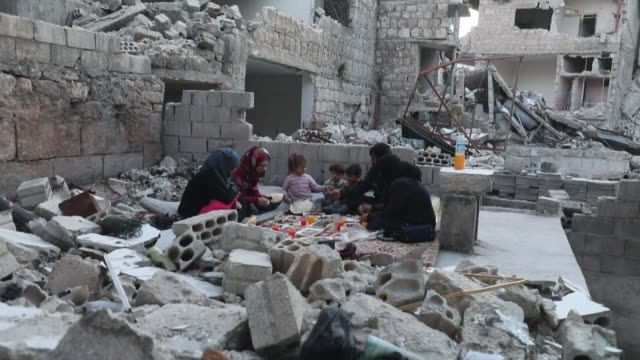 tareq abu ziad and his family break the daily fast for the muslim holy month of ramadan while sitting in the rubble of their destroyed home in the... - ramadan stock videos & royalty-free footage