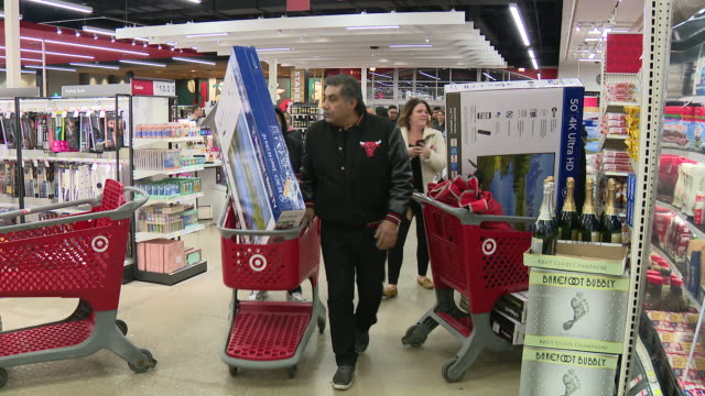 target and best buy both started black friday early by opening at 5pm on the evening of thanksgiving in chicago, illinois, usa, on thursday, november... - black friday stock videos & royalty-free footage