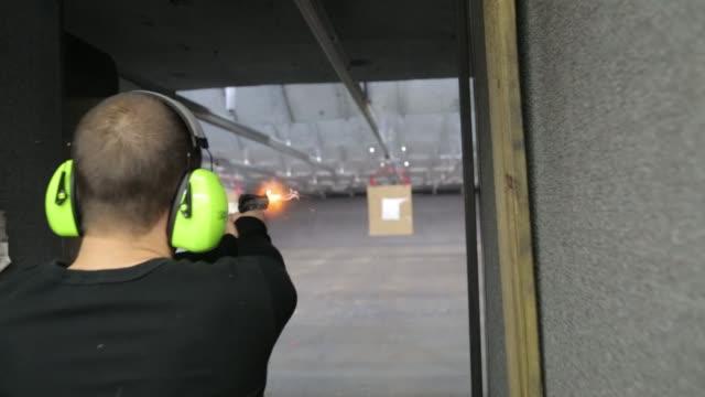 target practice at a gun range on april 28 2013 in chantilly va - target shooting stock videos & royalty-free footage