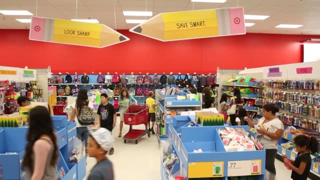 target store interiors customers browsing products target logo on shopping carts customers paying at cash registers target employees target store... - torrance stock videos & royalty-free footage