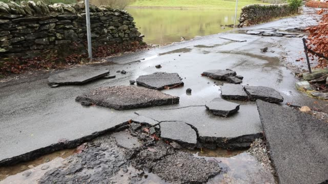 tarmac ripped off the road in ambleside by the floods from storm desmond. - tarmac stock videos & royalty-free footage