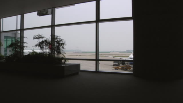 DS WS Tarmac through airport terminal windows / Inchon, South Korea