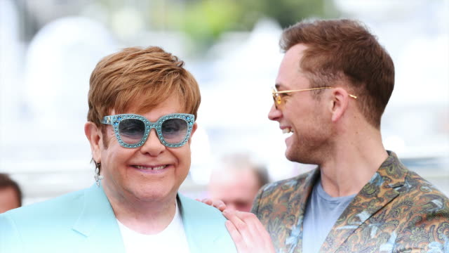 Taron Egerton and Sir Elton John attend the photocall for Rocketman during the 72nd annual Cannes Film Festival on May 16 2019 in Cannes France