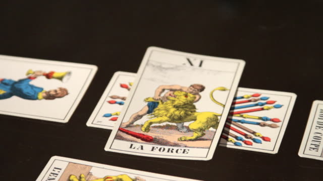 tarot cards showing the force card. - fortune telling stock videos & royalty-free footage