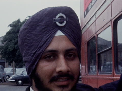 stockvideo's en b-roll-footage met tarseem singh sandha becomes the first sikh bus driver to work for london transport 1968 - informatiebord