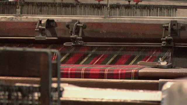 CU Tartan kilt being woven on a loom / Edinburgh, Scotland, United Kingdom