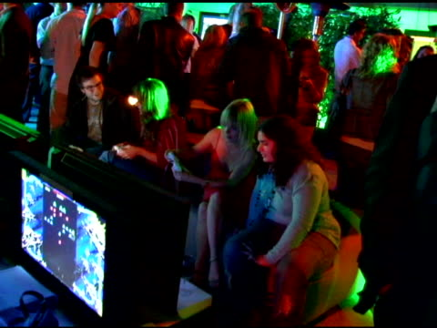 taryn manning playing x-box at the xbox 360 e3 party at the roosevelt hotel in hollywood, california on may 9, 2006. - taryn manning stock videos & royalty-free footage