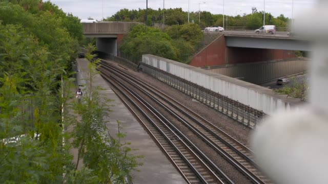 alex lanning trial hillingdon station england london hillingdon hillingdon station focus shots high angle view train tracks passing over road and... - crime and murder stock videos & royalty-free footage