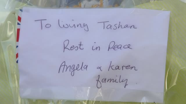 tributes paid england london hillingdon station ext floral tributes for tashan daniel outside railway station close shots of messages of condolence... - memorial stock videos & royalty-free footage
