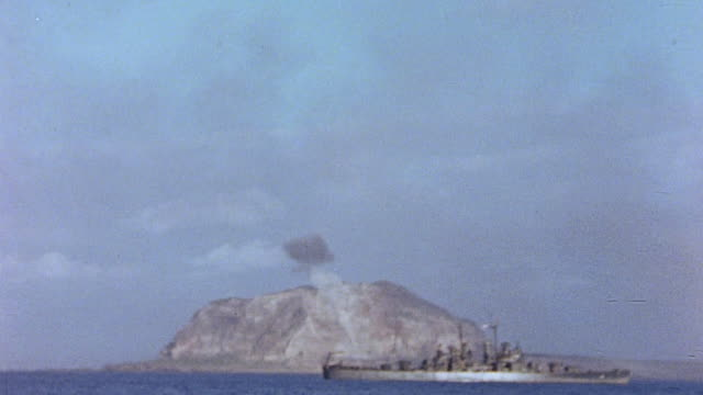 task force 52 bombarding the island and smoke rising from mount suribachi / iwo jima japan - iwo jima island stock videos & royalty-free footage
