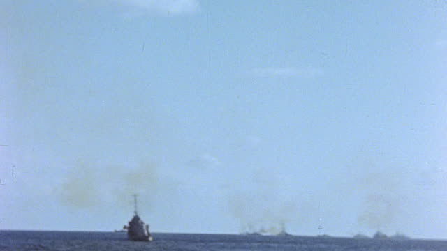 task force 52 including battleships bombarding the island / iwo jima japan - schlacht um iwojima stock-videos und b-roll-filmmaterial