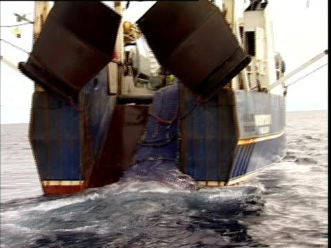 Tasman Sea, MS net being hauled onboard trawler.