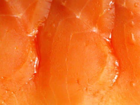 ntsc: tasty delicious sliced salmon (video) - salmon stock videos & royalty-free footage