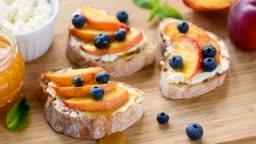 Tasty fruit bruschetta with ricotta cheese