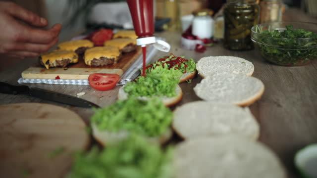 tasty homemade hamburgers - preparing food stock videos & royalty-free footage
