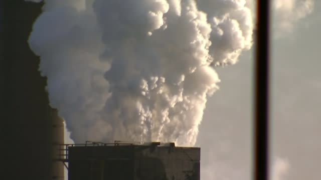 tata steel job losses; england: north lincolnshire: scunthorpe: gvs clouds of smoke rising from steelworks heat haze over steel works entrance to... - lincolnshire stock videos & royalty-free footage