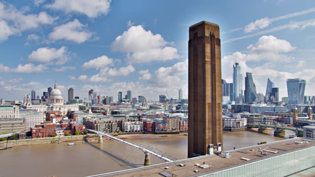 tate modern art gallery and financial district seen across london river - art gallery stock videos & royalty-free footage