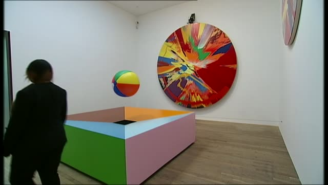 Tate Modern celebrates 15th birthday R02041208 / 242012 Spin painting by Damien Hirst in exhibition room Damien Hirst posing for photocall in front...