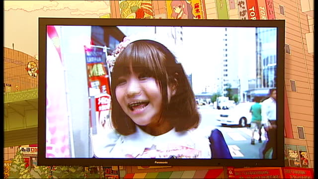 Pop Life Exhibition interviews and general views Takashi Murakami installation video 'Akihabara' showing actress Kirsten Dunst miming in music video...