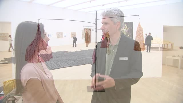 switch house extension opens to the public matthew gale interview sot artwork in gallery wide shot of artwork 'who owns what' by barbara kruger pull... - itv london lunchtime news点の映像素材/bロール