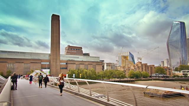 tate museum. art. people walk on bridge. london - male likeness stock videos & royalty-free footage